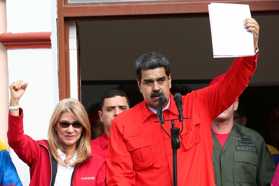 Venezuela's President Nicolas Maduro attends a rally in support of his government and to commemorate the 61st anniversary of the end of the dictatorship of Marcos Perez Jimenez next to his wife Cilia Flores in Caracas, Venezuela January 23, 2019. Miraflores Palace/Handout via REUTERS ATTENTION EDITORS - THIS PICTURE WAS PROVIDED BY A THIRD PARTY