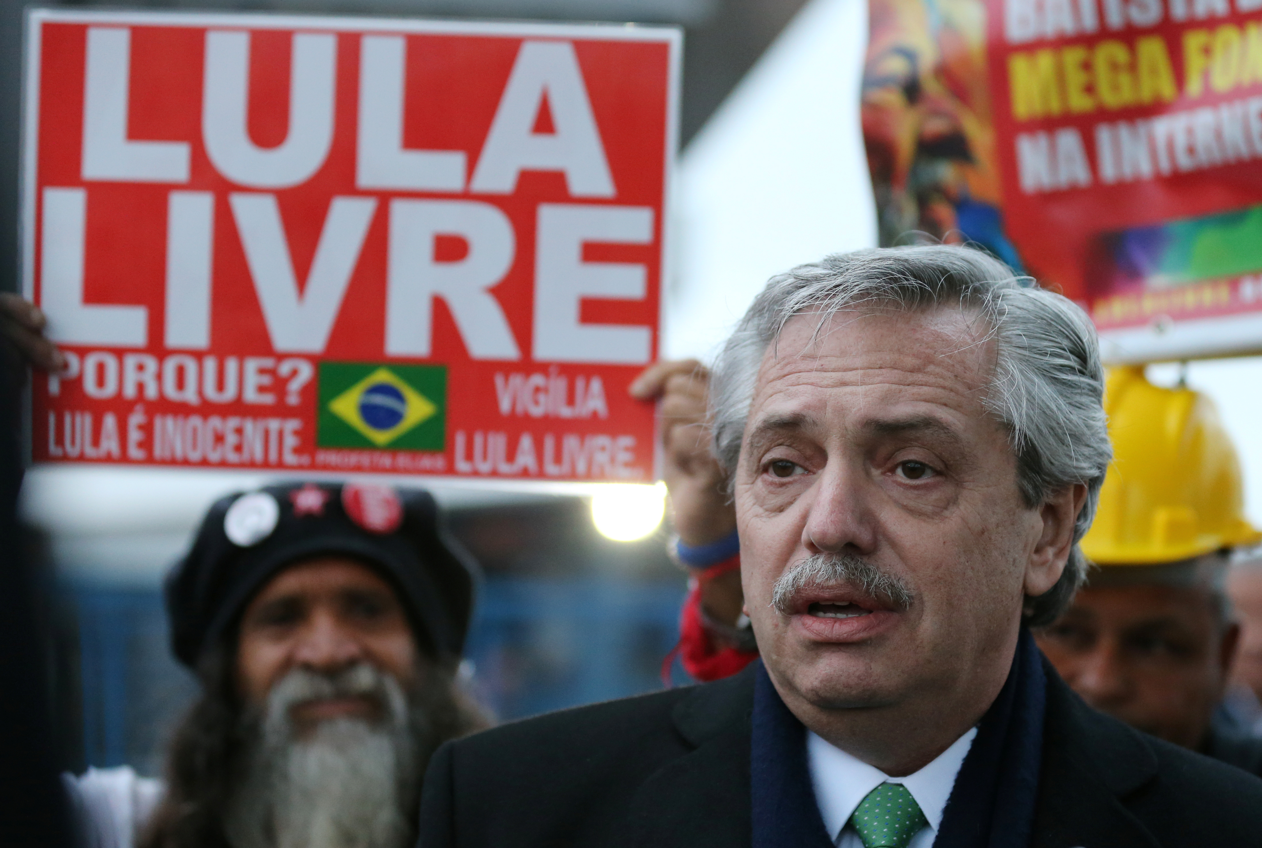 Argentina's Presidential candidate Alberto Fernandez leaves the Federal Police headquarters in Curitiba